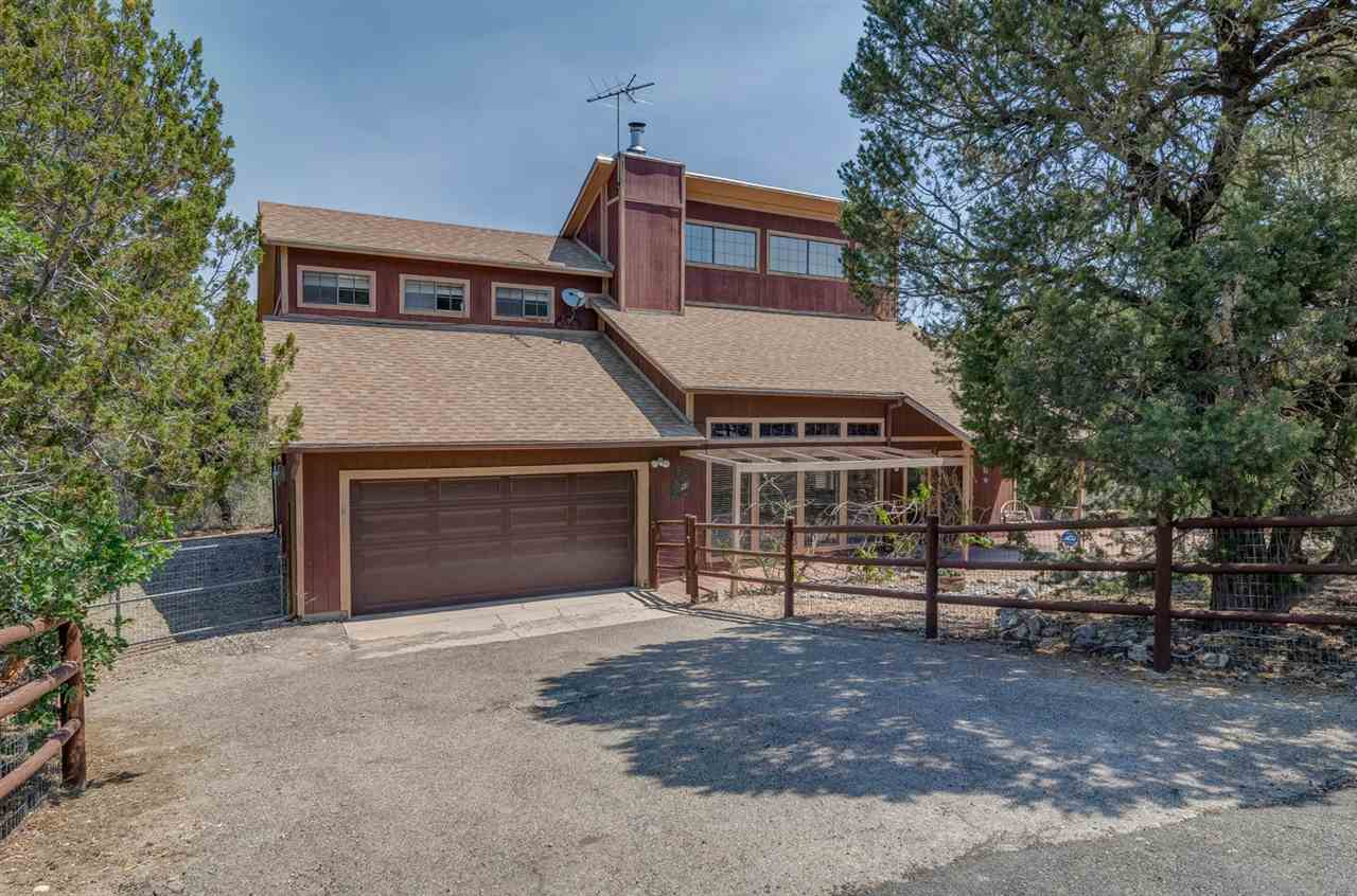 The GOOD LIFE begins at home in this beautifully maintained, mountain home set against nature's backdrop, offering wooded, mountain splendor and tranquility yet only 17 minutes from ABQ! Raised T&G ceilings, stunning engineered wood flooring in the living and dining areas, wood stove, newer roof, well, convection oven and refrigerator. Large windows create sun-drenched rooms. Spacious open deck, Paver Patio, Fenced dog run. A truly charming home with tremendous pride of ownership!