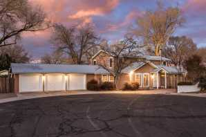 Experience a true gem of a Northern NM style home set on a private verdant .3 acre with mature trees, ditch irrigation and 5 varieties of fruit trees. The recent remodel by a well-known designer included kitchen and bathroom cabinets and countertops of Boos wood, marble, stainless and Richlite. A great room with soaring pine ceilings, spacious dining room, bedroom, full bath, den, hobby room and large laundry complete the main floor. The second floor with wood floors, a master suite with large view deck features two additional bedrooms and bath. Built with R-55 and R-40, the energy efficiency and refrigerated air accompany the great design and quality. 3-car garage plus additional carport, new coyote fencing.