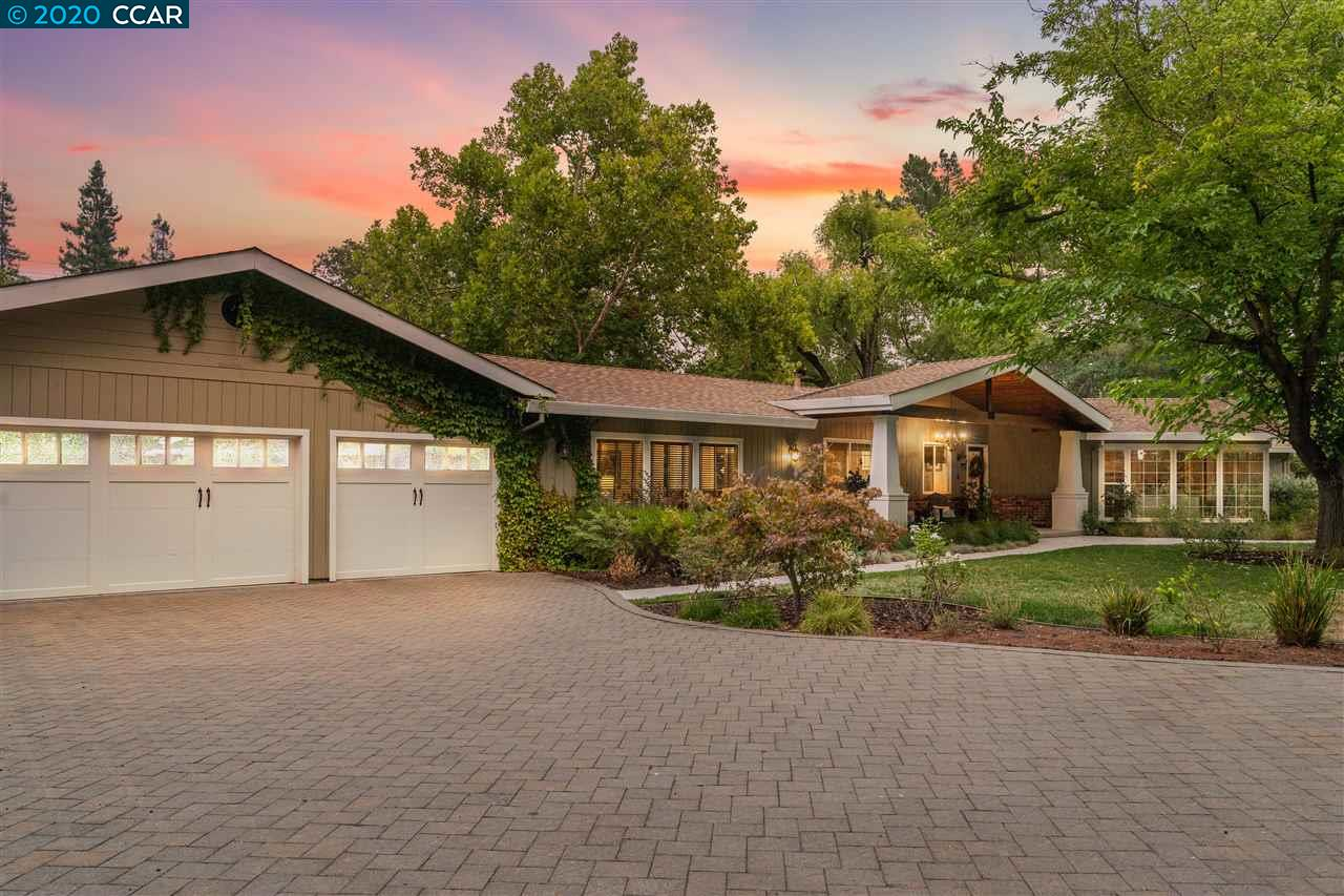 Custom single level home tucked away on private road in prestigious Westside Alamo. Over half an acre of flat premium lot, property has front yard w/charming front porch, lawn w/mature trees, bordered by 90 rows of French Clone Chardonnay vines. Backyard features expansive lawn & side yard, spacious patio, fire pit & backs to Iron Horse Trail. Open floor plan offers living room w/wood-burning fireplace & floor to ceiling windows, stunning hardwood floors, custom millwork & access to backyard from almost every room. Beautifully appointed kitchen offers stunning white cabinetry, Carrara marble counters/backsplash, DCS appliances, island & opens to dining area. Family room boasts incredible vaulted ceilings w/wood beams, gas fireplace & access to backyard. Home includes master retreat, bedrm w/ensuite, two more secondary bedrms & addl. wing w/in-law suite w/separate access, kitchenette, full bath & income potential. Walk to top-rated schools, Iron Horse Trail, hiking, shopp & restaurants.
