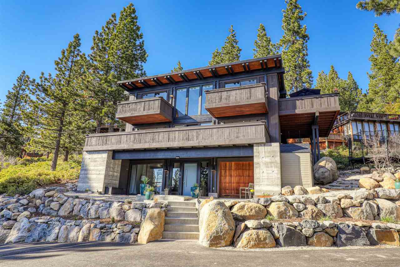 Architecturally designed by Richard Whitaker to maximize an abundance of natural light and Lake Tahoe views. This home offers an amazing opportunity to own within walking distance to Dollar Point's private sandy beach and boat access pier. Featuring 5 bedrooms, 4 bathrooms and over 3,000 square feet, there is plenty of room to spread out and relax. The top-level open floor plan is perfect for entertaining, allowing guests to take in 270 degrees of windows on 3 Southern-oriented decks.