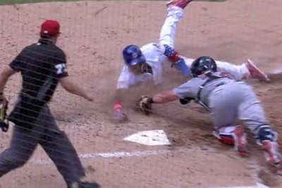 Watch: Javier Baez steals home with crazy slide around catcher Cubs Javier Baez steals home with mystifying slide
