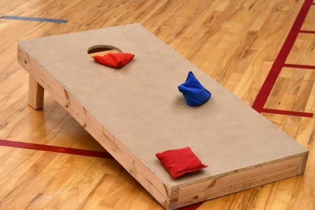 Company offers to pay someone ,000 to play cornhole