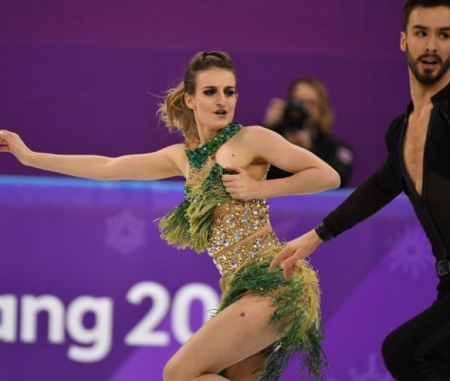Gabriella Papadakis Tries To Hold Her Costume Neck Strap After It Failed During Her Routine With Partner Guillaume Cizneros Of France During The Ice Dance