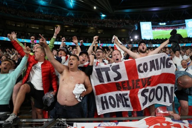 Fans of England celebrate after the Euro 2020 semifinal between England and Denmark at Wembley Stadium in London Wednesday. Photo by Carl Recine/EPA-EFE/Pool