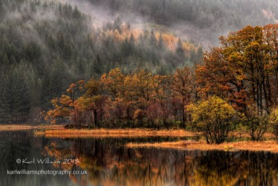 A misty, moisty Autumn morning at Loch Chon in the Scottish Trossachs - part of the Loch Lomond and Trossachs National Park by theoherbots