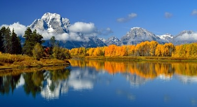 Autumn colors reflect into Oxbow bend along the Snake River below Mount Moran as the seasons change once again in Grand Teton National Park. http:--1 by theoherbots