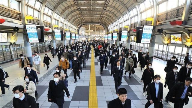 Japan says economy 'recovering' at 40-year high