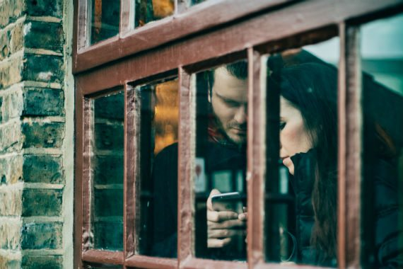 time management skills man texting standing next to girl