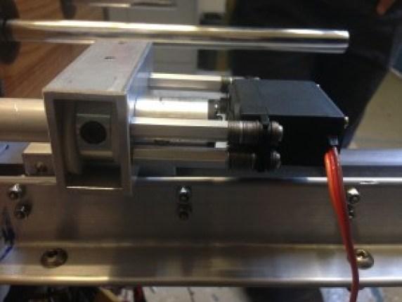 Rotational Actuator.  Left to right: thrust bearing, servo horn adapter, servo.