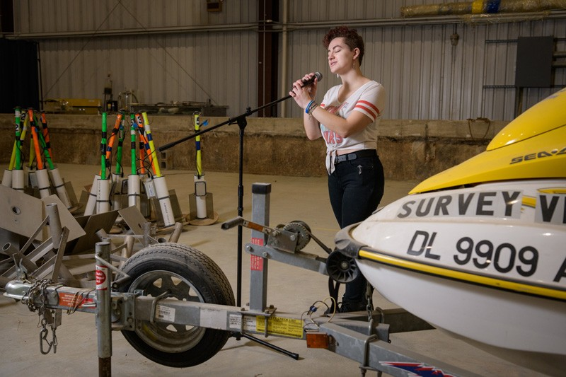 """Sydney Cargill, member of the a capella group DelReMi, says she's """"transported to a different world"""" when she sings, which she does even while at work in the Coastal Engineering Lab, pictured here."""