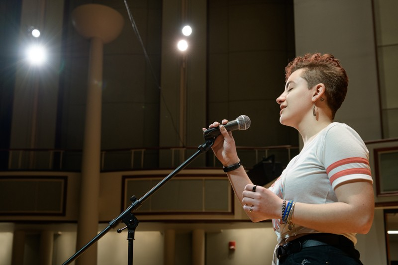 "Sydney Cargill sings an a capella version of Adele's ""Skyfall"" on stage at the Gore Recital Hall."