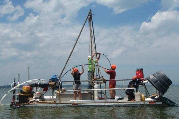 grad students and researchers on a barge