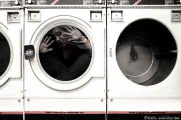 photo of woman trapped in front-loading washing machine