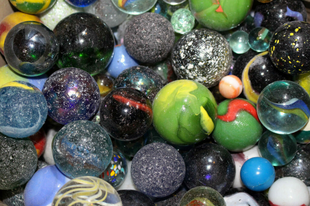 photo of different colored marbles