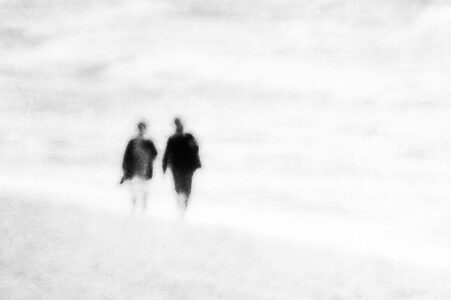 photo of two people walking in the distance