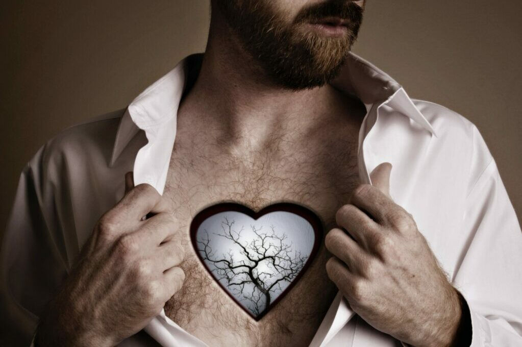 photo art of man with heart-shaped hole in chest