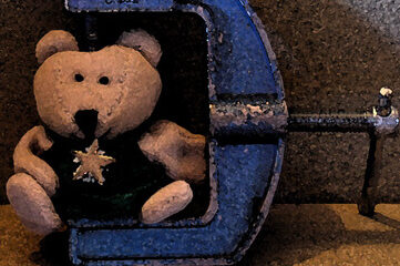 photo of teddy bear in a c-clamp