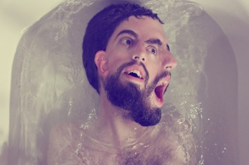 photo of a man's partially submerged face