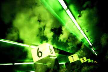 cloudy green photo of aisle numbers in a store