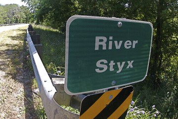"photo of sign that says ""River Styx"""