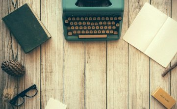 photo of green typewriter on a table
