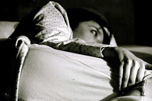 photo of a woman trying to sleep