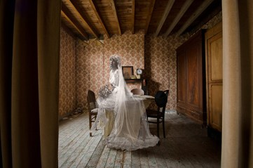photo of bride dressed in old-fashioned wedding dress