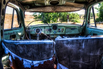 photo of the interior of an old abandoned car