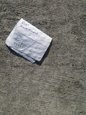 photo of discarded grocery list on the ground
