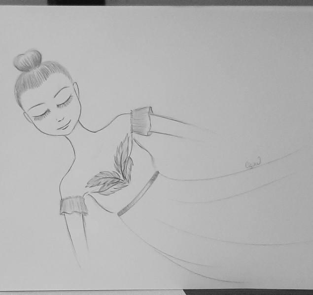 Danseuse dans une tenue de plumes et de voiles
