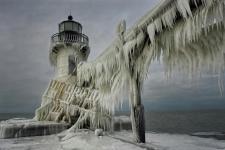 Frozen lighthouse - Lake Michigan, USA Photo by Thomas Zakowski