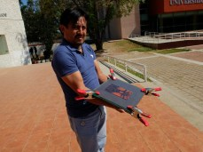 Victor Calerón exposes a solar plate image to sunlight.