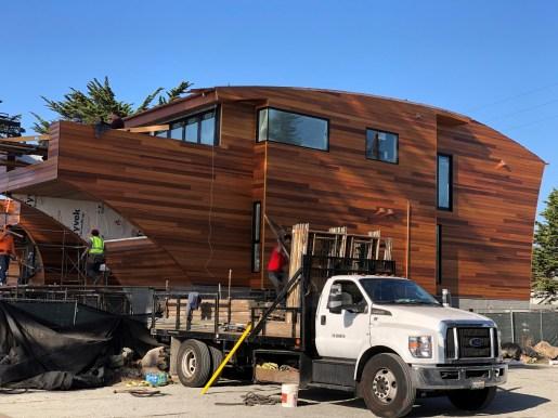 custom cut western red cedar siding being installed on a home in california