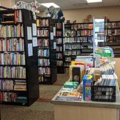 Stacks of fiction, bins of children's books, and games in the Book Nook store.