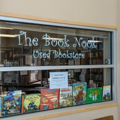 The Book Nook store window, lined with children's picture books.