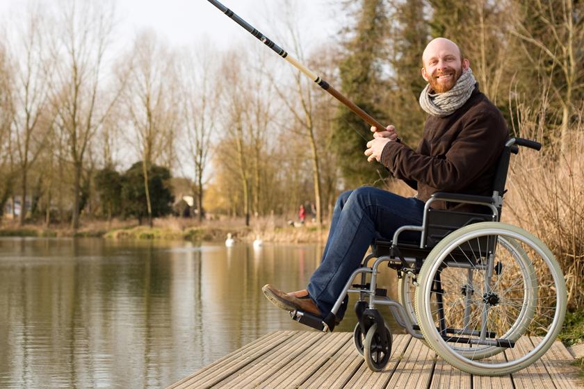 Man in wheelchair fishing