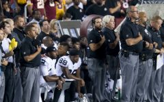 NFL Players Protest by Taking a Knee