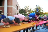 Students ravage their pies during the pie-eating contest held at FestiFall. (Photo: Tianle Li)