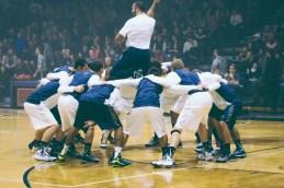 The men's basketball team huddles before their game. (Photo: Jillian Philyaw)