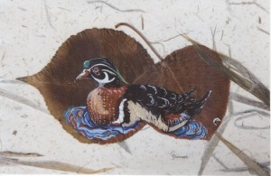 Cooley Turner, a man of many stories and talents, has challenged himself to paint on leaves, as well as feathers.