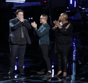 "Brian Johnson is moving onto the final round of NBC's ""The Voice"" after a surprise move by Coach Adam Levine. Johnson wasn't chosen by America's votes, but Levine chose Johnson as the final member of his team headed to the Live Performance Shows (photo by: Tyler Golden/NBC)."