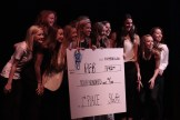The members of Phi Epsilon Beta pose on stage with their second-place prize on the final night of Org Wars, Nov. 13.