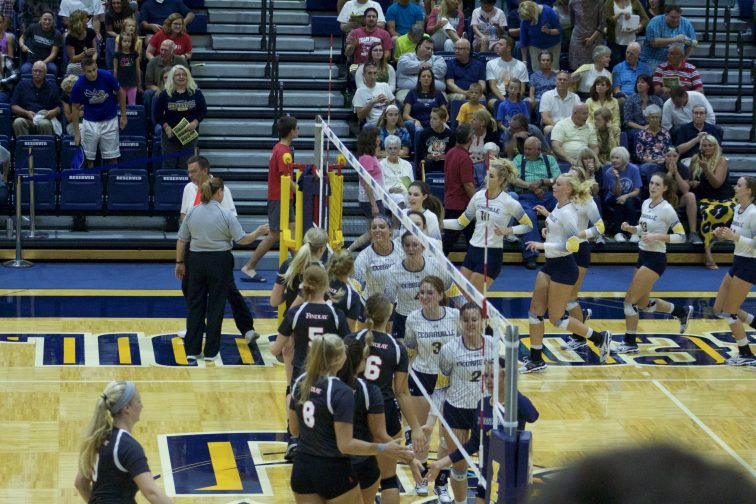 The CU women's volleyball team shook hands with the opposing team.