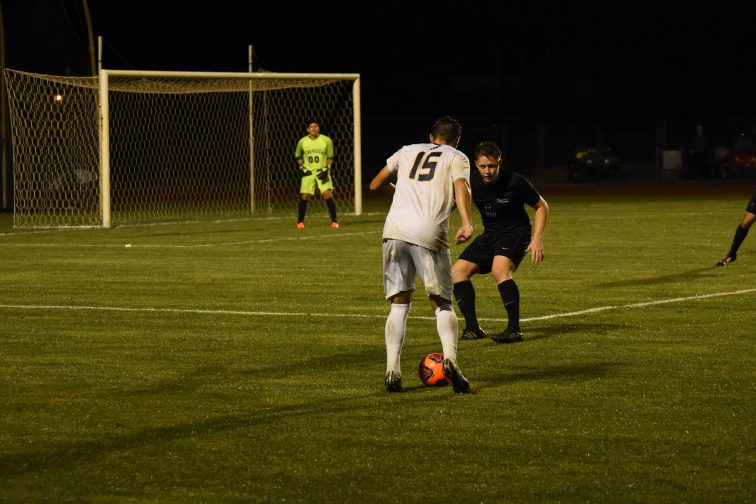 Connor Gilmour works the ball against a Trevecca defender. (Photo: Campbell Bortel)