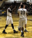 Robert Okoro (left), Patrick Bain (middle) and J.C. Faubion (right) high five each other (Photo: Christian Cortes).
