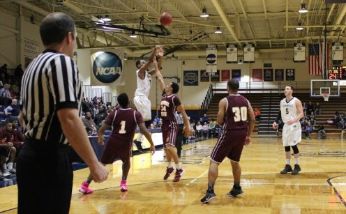 Justice Montgomery shoots over a Central State defender (Photo: Alex Weber).