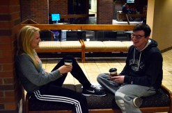 """Find a place to sit, relax, and enjoy the conversation. It is really fun if you put some effort into it. Make sure your phone is off or put away though [smiles]."" (Freshmen Kimmy Powell and Noah Augustus enjoy quality time at the most recent Coffee & Community. [Photo courtesy of Allyson Weislogel])"
