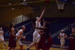 Taylor Buckley drives to the basket (Photo: Allyson Weislogel).