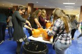 Sophomore Olivia Taylor (left) enjoys a night of pumpkin carving with her friends.