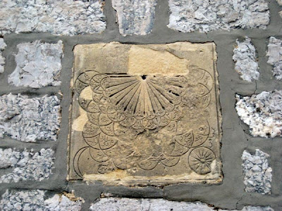 The entrance to the monks' quarters is headed by this complex solar dial that doubles as an astronomy tool with the names of the constellations and main stars.
